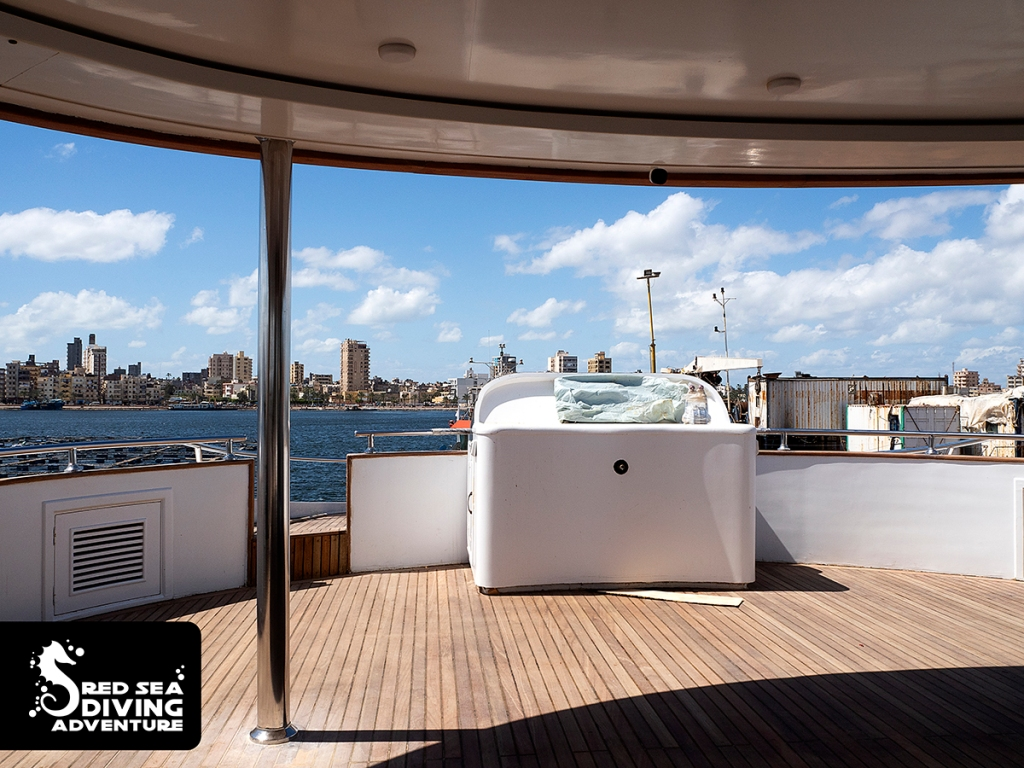 The top deck view toward the stern. The extra wheel in the front and the entrance to an extra sundeck.