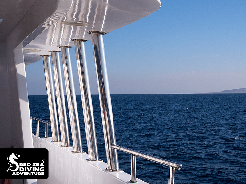 Stainless steel railing, a stunning white yacht and the blue sky and indulging sea. Liveaboards are the best.