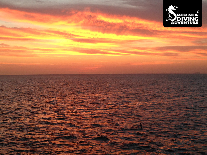 Stunning red skies over the Red Sea are often seen as small clouds form over the horizon as night falls.
